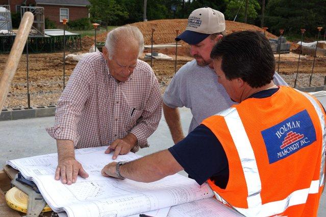 Holman staff reviewing building plans